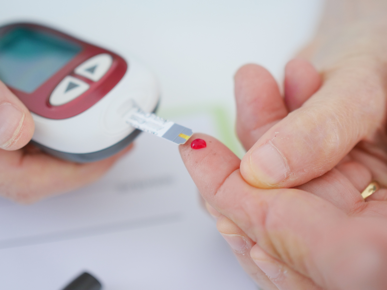 Close up of a person taking a blood sugar test