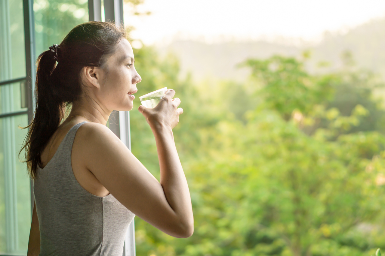 A woman drinking dietary supplements