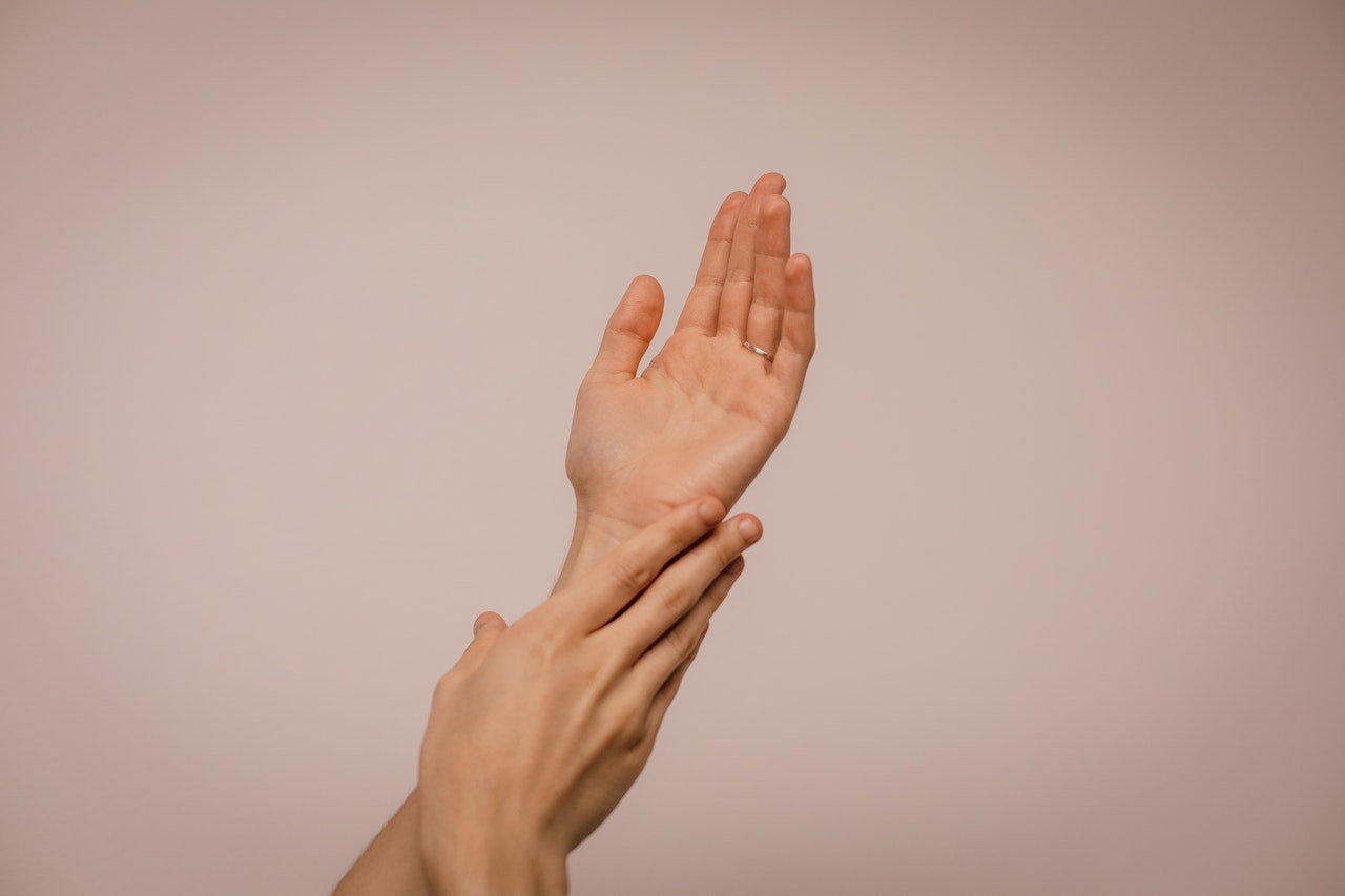 A person's hands with healthy skin
