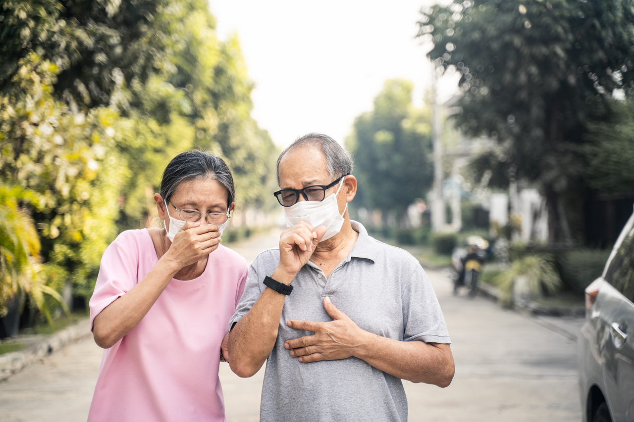 An elderly couple wearing face masks during the pandemic
